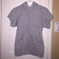 Gray zip up sweatshirt with hood. Shortsleeved gray zip up with hood. From Charlotte Russe, name on tag is Blu Chic. Worn about three times. Charlotte Russe Tops Sweatshirts & Hoodies