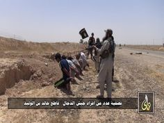 An ISIS execution in Syria-Iraq. Islamic State fighters executed teachers in Mosul for refusing to teach the ISIS curriculum in ...