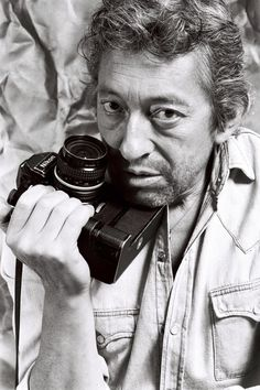 Serge Gainsbourg with a Nikon camera, photographed by Pierre Terrasson