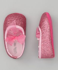 Take a look at this Pink Glitter Bow Flat by Little Me!