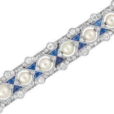 Art Deco Platinum, Pearl, Diamond and Sapphire Bar Pin  9 pearls ap. 4.0 mm., old-mine & single-cut diamonds, c. 1920, ap. 6.2 dwt.