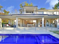 Geometric pool design using glass with bbq area & outdoor furniture setting - Pool photo 223596