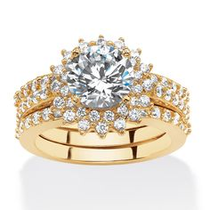 The sparkle and golden glow of this stunning vintage-style round cubic zirconia ring is spectacular.