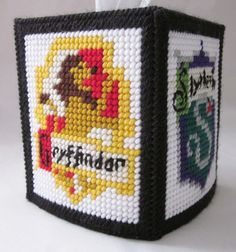 Harry Potter Hogwarts houses tissue box cover in plastic canvas PATTERN ONLY. $6.00, via Etsy.