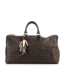 This is an authentic LOUIS VUITTON EDUN Monogram Revelation Keepall 45 Bandouliere in Brown. This chic travel tote is crafted of fine Louis Vuitton monogram textured dark brown leather.