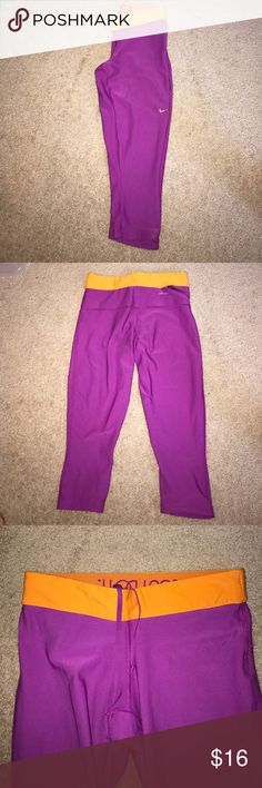 Nike Crop Legging with Drawstring In great condition, gently used, vibrant colors! Purple/pink and neon orange waistband. Nike Pants Leggings