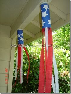 Visit blog for how-to, but: blue paper, white stars stuffed into a sheet protector, white trash bag streamers