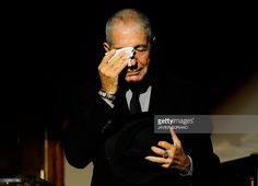 Canadian singer Leonard Cohen wipes his tears during the concert 'A Tribute to Leonard Cohen' at the Jovellanos Theatre in Gijon, on October 19, 2011. Cohen will receive the Prince of Asturias Award for Letters from Spain's Crown Prince Felipe during a ceremony on October 21, 2011 in Oviedo.