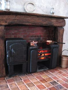 Georgian kitchen grate with fire by dangerousmezzo, via Flickr