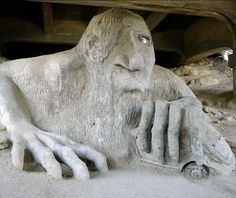 Fremont Troll, Seattle  In the shadow of an overpass in the Fremont neighborhood of Seattle lurks a giant one-eyed troll clutching a Volkswagen Beetle. The two-ton sculpture was created in 1990 by a team of four local artists, Steve Badanes, Ross Whitehead, Will Martin, and Donna Walter, as part of a competition promoting urban renewal. The ugly ogre was originally overlooked by the judging committee. But it charmed locals, winning the popular vote and the right to haunt the underpass foreve...