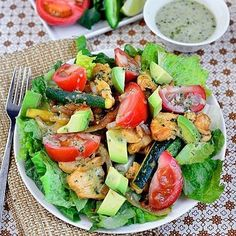 Chicken Fajita Sizzling Salad by @iowagirleats - Credit: @iowagirleats -full recipe with directions on her blog. Check her out! - Ingredients: 12oz chicken breasts cut into strips 1/2 onion thinly sliced 1 zucchini cut into sticks or 1 green bell pepper sliced 1 tbsp canola or vegetable oil divided 6 cups chopped romaine lettuce 1 tomato cut into wedges 1/2 avocado chopped For the marinade: juice of 1/2 lime 1-1/2 tbsp olive oil 1 garlic clove crushed 1/2 tsp salt 1/4 tap cumin 1/4 tsp chili…