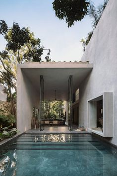 The living room opens straight on to an outdoor swimming pool of this private villa in Tulum, designed and built by Mexican firm CO-LAB Design Office. Tulum Mexico, Outdoor Swimming Pool, Swimming Pools, Concrete Masonry Unit, Villa, Style Deco, Rooftop Terrace, Terrazzo, Ground Floor