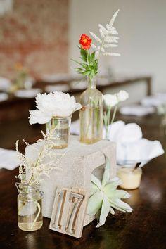 Concrete block wedding centerpieces with vintage bottle vases ~ we ❤ this! moncheribridals.com