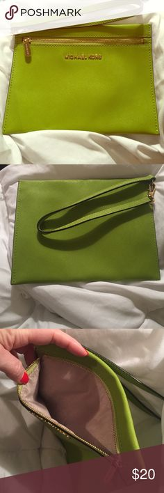 """Michael Kors Large Wristlet Pouch - lime green Genuine Michael Kors Jet Set wristlet/pouch in beautiful chartreuse leather. Slim, yet spacious - perfect for your phone, compact, and lipstick whether at a Colts game or girls night out! Measures about 8.5"""" x 6.5."""" Bought new and never ended up using it - looking for a new home! MICHAEL Michael Kors Bags Clutches & Wristlets"""