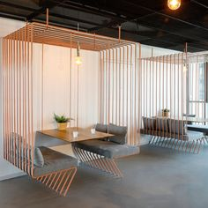 This Tel Aviv office design for a software company includes minimalist meeting spaces that appear like open cages within the space. #OfficeDesign #ModernOffice #OfficeSeating #Workplace