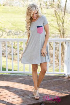 This super comfortable t-shirt dress is a perfect way to show off your American pride and stay cool in the summer heat! We adore the soft fabric and the adorable pocket! It features a band of stars on a navy background paired with red and white vertical stripes for a new twist on the flag pattern.