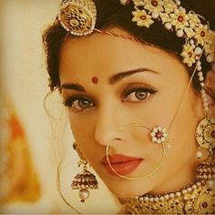 OMG: The gorgeous Aishwarya Rai as an Indian Bride with exquisite, distinctive Indian bridal jewellery, including matha patti with maang tikka (on hair), nath (on nose) and jhumka earrings. Opal Jewelry, Indian Jewelry, Wedding Jewelry, Tiffany Jewelry, Diamond Jewellery, Wedding Wear, Desi Wedding, Hair Wedding, Wedding Shoot