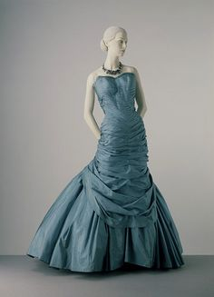 silk taffeta the bodice mounted on a boned foundation the skirt supported by net