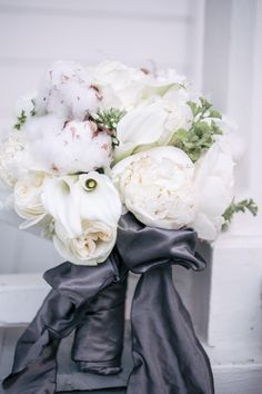 Winter white wedding bouquet filled with fluffy cottony peonies.