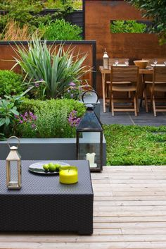 like the combination of grey raised planters and decking