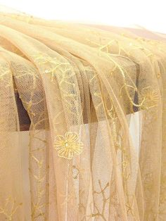 Embroidered tulle 110 inches wide ecru with beige by Eleptolis, $106.00
