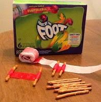 Fun scroll snack.  Make scrolls out of Foot Long Fruit Roll-ups and Pretzel Sticks.