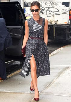 Victoria Beckham wears one of her own designs in New York, featuring a rosebud pattern on a navy blue background http://dailym.ai/1hMecJj