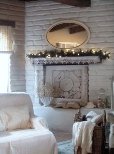 White cottage; simple mantle decor; love the oval mirror