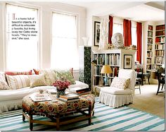 Shabby Chic - I like the blue/turquoise rug and orangish/red curtain combo