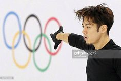 SOCHI Russia Japanese figure skater Daisuke Takahashi skates in front of the Olympic rings during official practice for the men's competition at the...