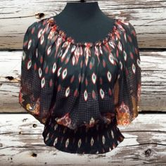❌FINAL PRICE ❌🍂CUTE FEATHER PRINT BLOUSE🍂 Love this blouse with the flowy sleeves and feather print.. It has a pull on the front just below bust, which as you can see in first pic is not noticeable unless close up. Price reflects blemish Ultra Pink Tops Blouses