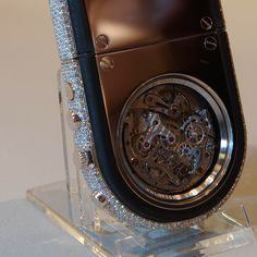 Only 3 pieces were made of this phone, the Revolution. Full pave VVS diamonds on the side and a tourbillon watch is integrated