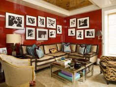 Philip Gorrivan. Love the oyster shell sofa and dark scarlet walls. Really dislike all the fringe :(