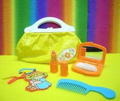 Fisher Price first purse. I don't remember if it was mine or one of my older sisters?  I loved the compact though!