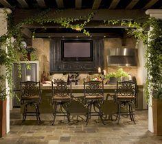 Lush greenery, modern appliances, iron bar stools…Elegant outdoor kitchen!  | decorhomeideasbest.com