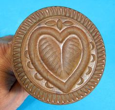 "#14 Antique Butter Print of a Heart. This is a two piece with screw off handle butter stamp that has a heart. It measures 3 1/8"" in diameter. It is roughly 5 1/4"" tall. It shows age and use appropriate wear.  Sold 7/6/14 on ebay for $222."