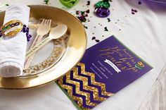 Throw the ultimate Mardi Gras party with glitter invites and colorful table decor.