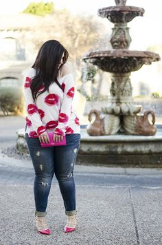 A casual Valentine's Day look on the blog - nothing say chic like a lippie sweater, ripped jeans and studded heels.