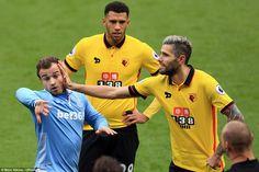 Watford midfielder Valon Behrami (right) lays a playful hand on fellow Swiss international Xherdan Shaqiri