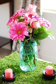 Pink flowers in blue mason jar