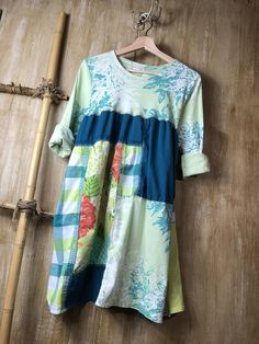 This romantic dress/tunic is perfect for spring, casual and comfortable and fun and funky. Clothes to live in with ties in the back are figure flattering. Pieced patchwork and lots of unique stitching. Approximate measurements Bust area - 22 with stretch Length - 33 uneven hem