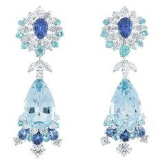 "Van Cleef & Arpels Robe Couleur du Temps earrings, ""Peau d'Âne raconté par Van Cleef & Arpels"" collection. White gold with diamonds, tourmalines, sapphires and two pear-shaped aquamarines for a total of 24.13 carats."