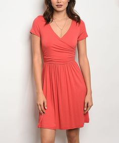 Take a look at this Coral Surplice Dress today!