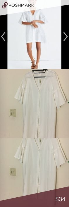 Madewell bell sleeve white shirtdress size L NWT This is a beautiful Madewell summer 2017 dress, but runs oversized for size L.   I love the bell sleeve. It hits me at the knee. You'll need to wear a slip as it is not opaque. I hate to let this go, but a little too big on me! Madewell Dresses