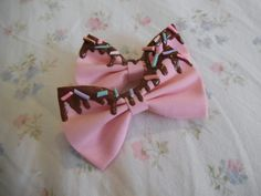 Cute chocolate drips sprinkles bow $3.00! I am getting this for sure. Unless I can make it...