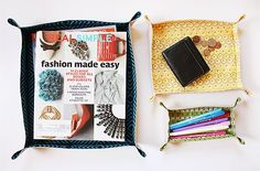 DIY Fabric Trays by Noodlehead: Instructions for 3 different sizes, customizable as simple or complex as you like. Use them for anything from storing magazines to holding pens  pencils to keeping your keys and wallet and cellphone in one place. A tall one might be a nice bread basket. A great reuse for scraps!    DIY