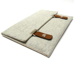 Stylish sleeve made with light gray and white herringbone wool tweed. Sized to fit 13 or 15 MacBook (choose your device from the drop down menu) or