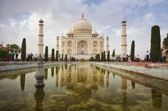 The Taj Mahal is widely considered one of the most beautiful buildings in the world. Image by Tetra Images - Bryan Mullennix / Brand X Pictures / Getty Images. Gustave Eiffel, Stonehenge, Machu Picchu, Agra, Beautiful Buildings, Beautiful Places, Amazing Places, Places Around The World, Around The Worlds