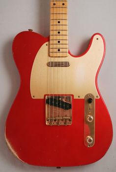 Fender Custom Shop '52 Telecaster Relic (Candy Tangerine) A custom variation on a classic theme. One of Fender's greatest guitars now boasts colors and features that could have seen in 1952 but weren't. £2299 #fender #telecaster #custom #1950s #vintage #red #candy