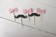 Gender Reveal Cupcake Toppers- Pink Bows, Black Mustaches- Baby Shower Decor- Gender Reveal Party by Prettyinpinkparty on Etsy https://www.etsy.com/listing/186841342/gender-reveal-cupcake-toppers-pink-bows